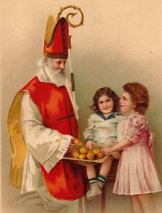 San Nicolás ofreciendo manzanas a los niños.